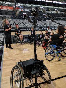 An image of Brooke Matula speaking to adaptive athletes