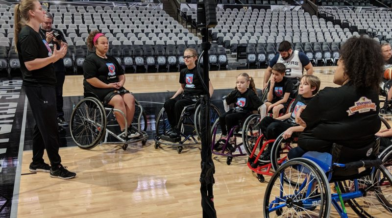 An image of STRAPS' Brooke Matula speaking to a group of adaptive athletes about The IMG Studio's new VR basketball game.