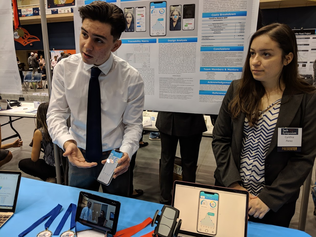 An image of two students demostrating their vestibular AR app