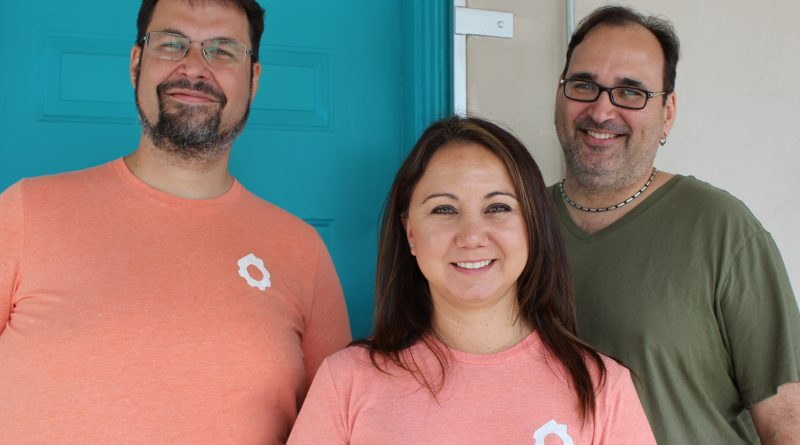 Brokerage Engine co-founders (from left) Dirk Elmendorf, Brianne Alston, Brett Elmendorf, and J Kuper (not pictured) stand in front of the Brokerage Engine office at 601 Delaware Street in San Antonio.