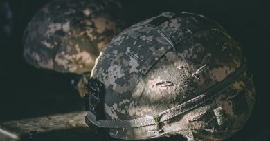 Army combat helmets photo taken by Israel Palacio on Unsplash.