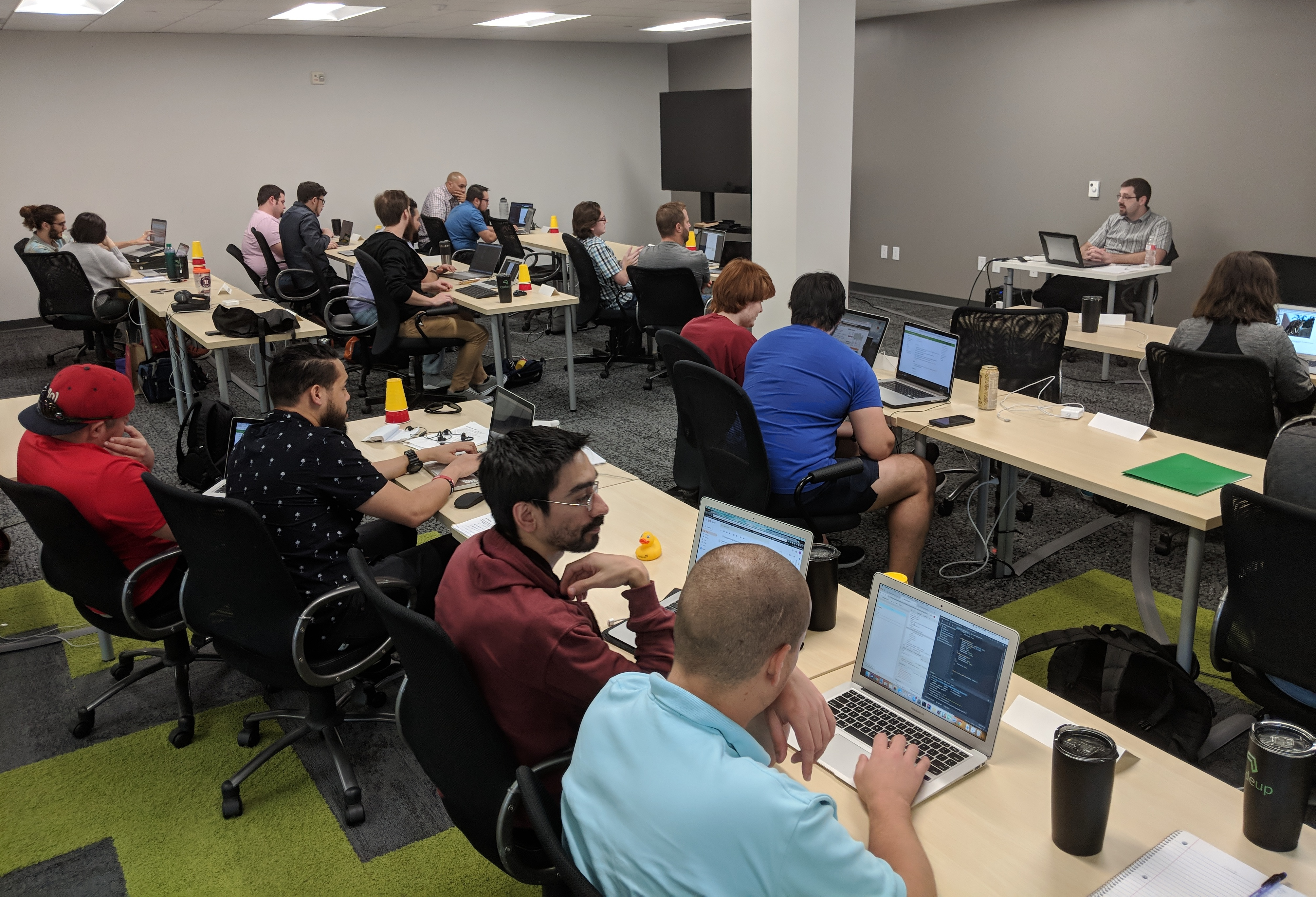 A class of students learn software development at CodeUp.