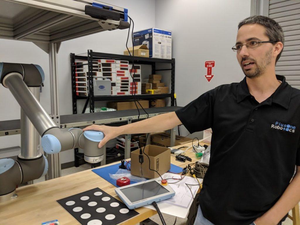 Plus One Robotics co-founder and CTO Shaun Edwards explains the 3-D camera system for robots. Photo credit: Startups San Antonio.