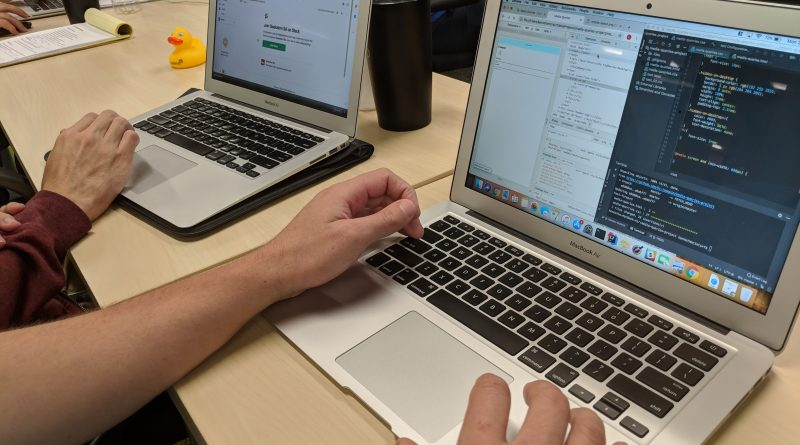 A closeup of laptops of two students in a Codeup web developer class. Photo credit: Startups San Antonio.