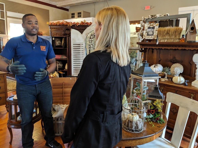 MoveIt founder Michael DeRouen (left) speaks to The Sanctuary for the Vintage Soul antique store employee Elizabeth Busch. Photo credit: Startups San Antonio.