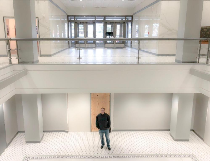 The District's founder Nick Longo stands out the basement entrance in the Rand Building where Geekdom's new entrepreneurship school will be based. Courtesy photo.