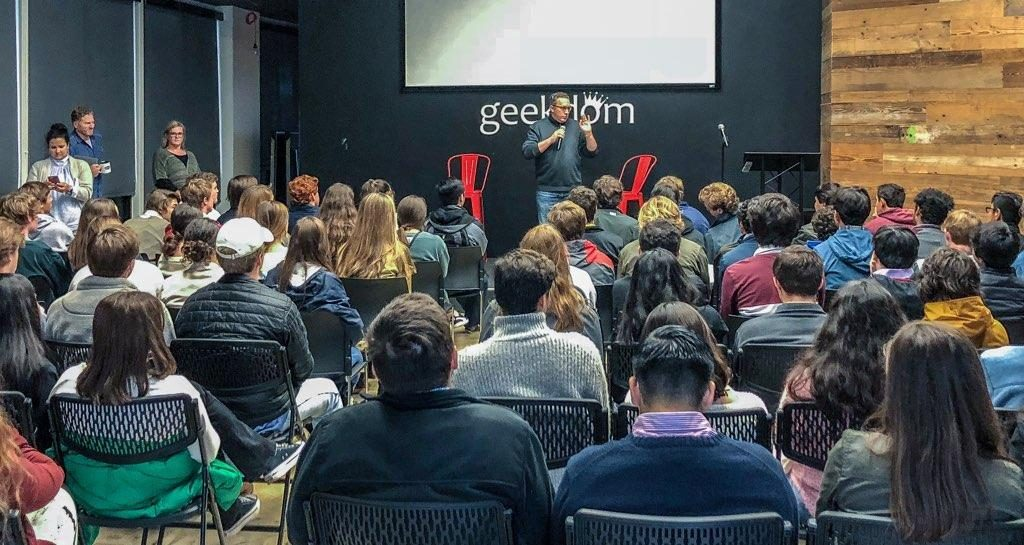 Creator of The District Nick Longo teaches a class of students at Geekdom