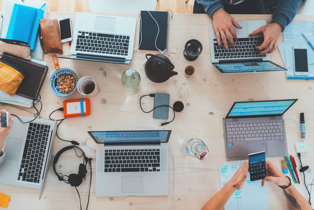 Laptops on a table. Photo credit: Photo by Marvin Meyer on Unsplash