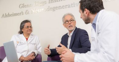 (From left) Dr. Sudha Seshadri, Rick Morris, and Dr. Carlos Jaramillo discuss GaitIQ at the Biggs Institute. Photo credit: UT Health San Antonio.