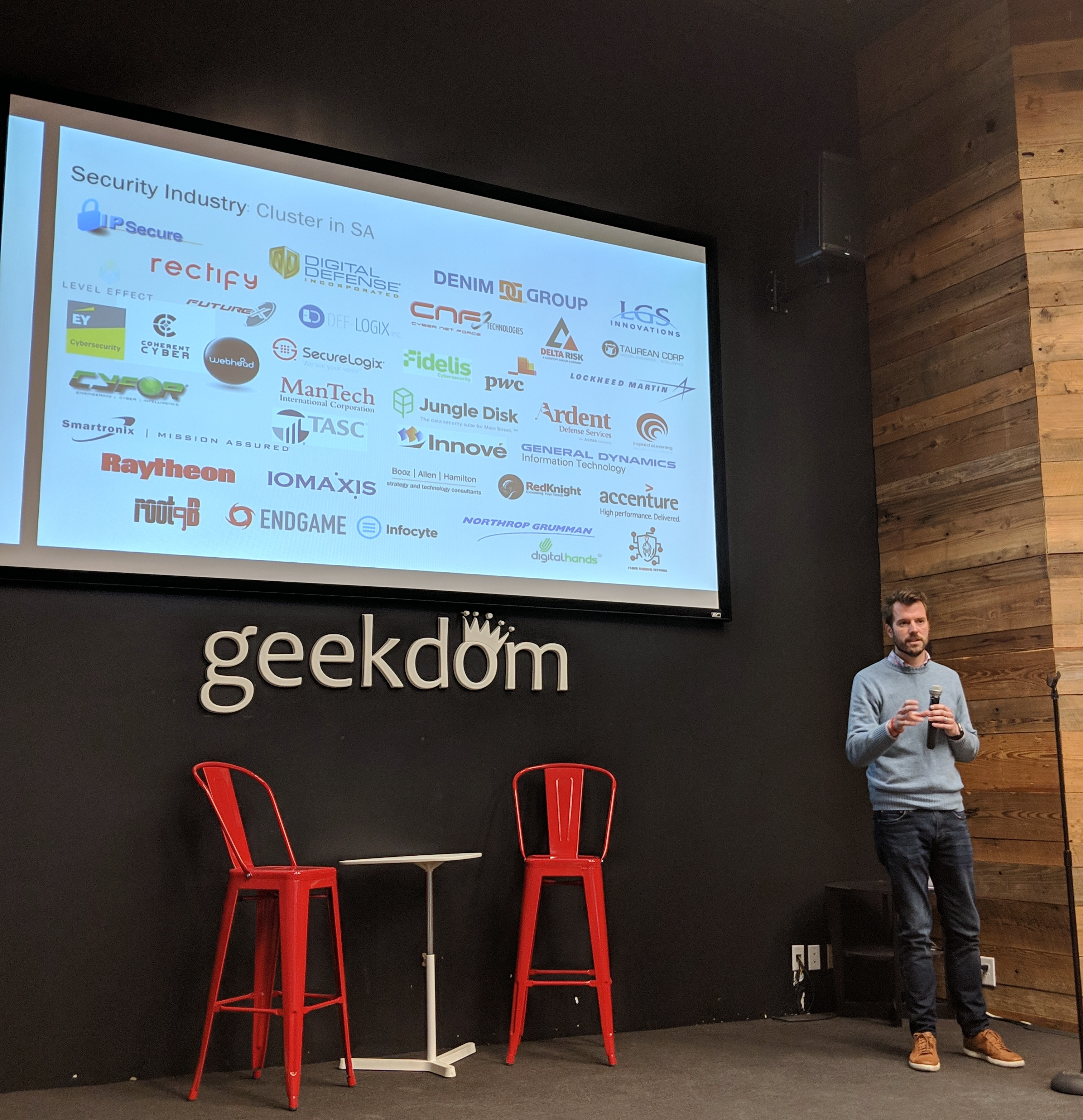 Port San Antonio vice president for cybersecurity Will Garrett talks about the growth in San Antonio's cybersecurity community at the Geekdom State of the Ecosystem. Photo credit: Startups San Antonio.