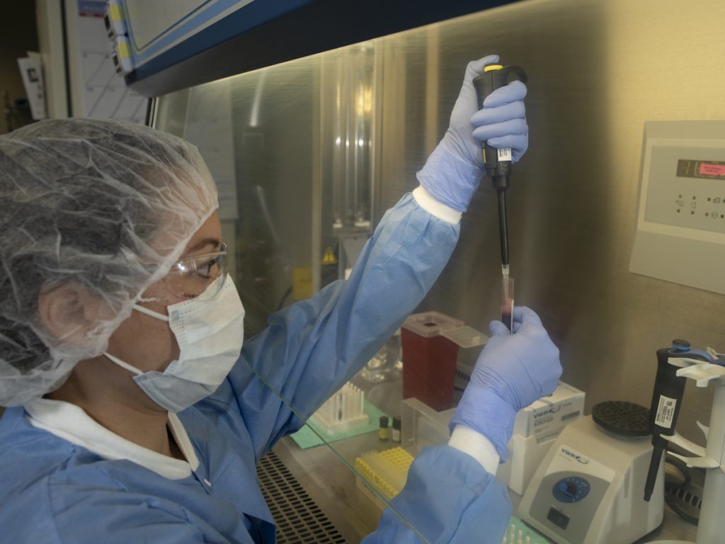 A member of the GenCure biomanufacturing team tests cord blood stem cells in the center's clean room facility. Courtesy photo.