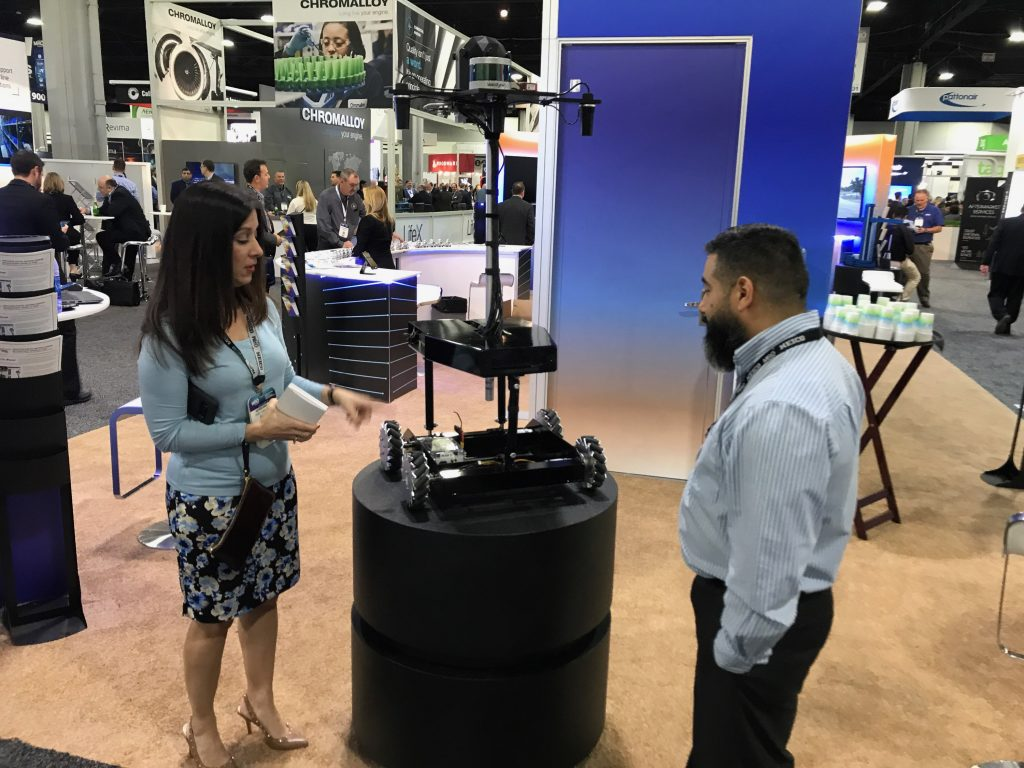 Reckon Point founder Gabe Garza talks to a MRO Conference attendee. Port San Antonio courtesy image.