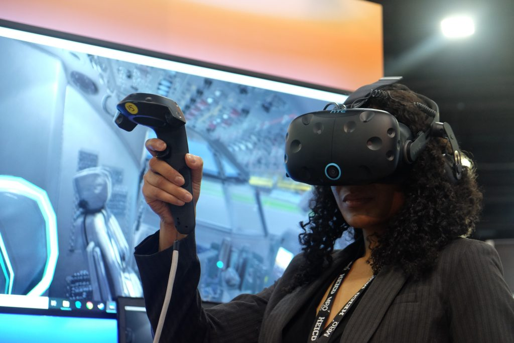 JaDrian Whitfield from Booz Allen Hamilton demonstrates the company's virtual reality training content. Courtesy image.