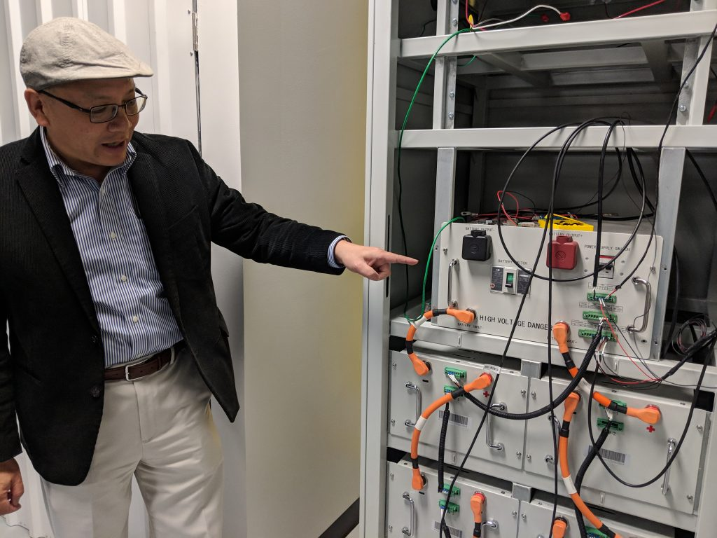 Leaptran CEO Jeff Xu opens a 35 kW integrated battery energy storage system (BESS) prototype with remote asset monitoring capability control system. Photo credit: Startups San Antonio.