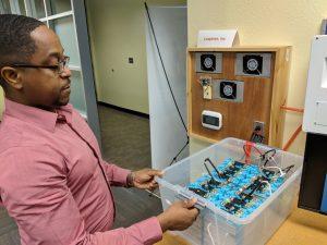 Leaptran's COO Edward Hooks explains a lab-based energy storage system (BESS) Photo credit: Startups San Antonio.