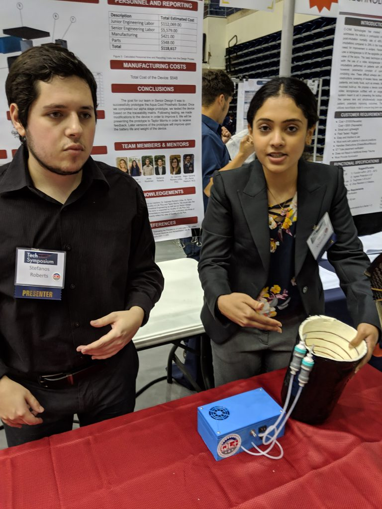 Two JNST team members show its cooling prosthetic medical device prototype. From left: Stefanos Roberts, Toral Khajanchi. Photo credit: Startups San Antonio.