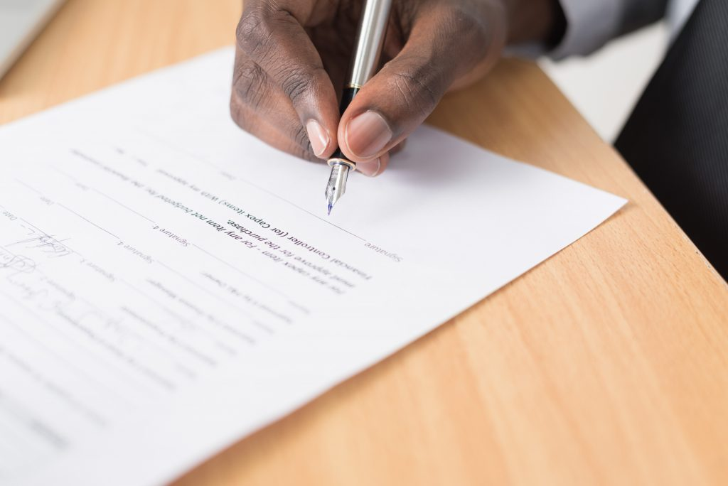 Signing a check isn't easy for an investor. Photo credit Cytonn Photography on Unsplash.