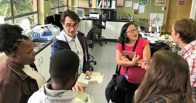 Dr. Jordi Torrelles talks in researchers about TB testing Texas Biomed courtesy photo