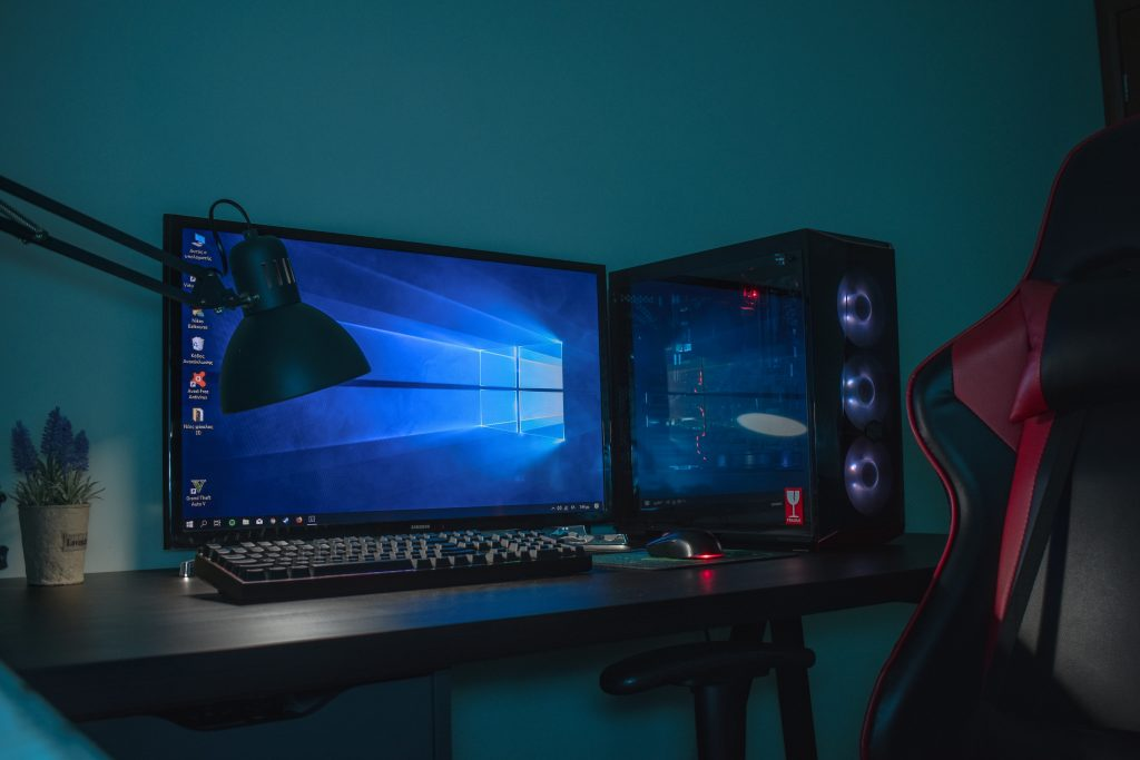 Image is of a desktop computer set with black and gray leather gaming chair. Photo by Balk Nick on Unsplash.