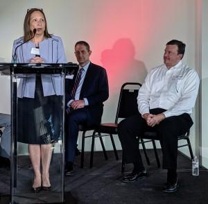 CNF Technologies CEO Roxanne Ramirez speaks while Port San Antonio CEO Jim Perschbach and CNF Technologies COO Stephen Barish (right) listen. Photo credit: Startups San Antonio.