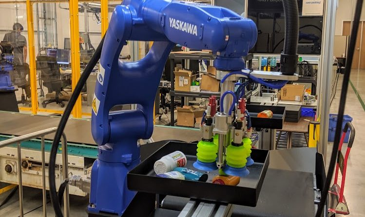 A Yasakawa robot picks up a package at Plus One Robotics. Photo credit: Startups San Antonio.