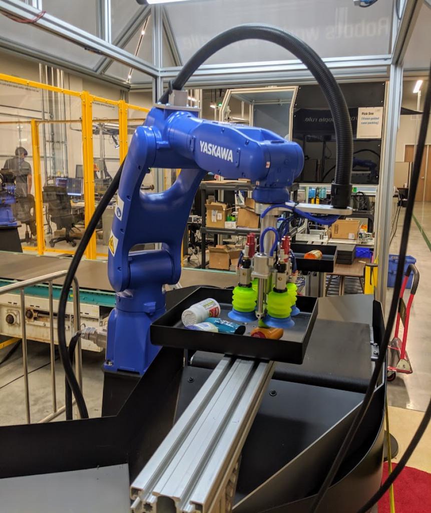 A Yasakawa robot picks up a package at Plus One Robotics. Photo credit: Startups San Antonio.
