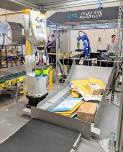 A robot picks through items for packing and shipping. Photo credit: Startups San Antonio.