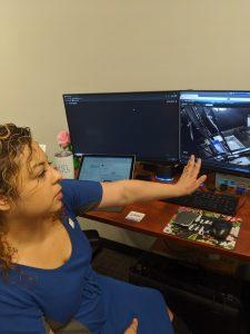Plus One Robotics crew chief Grace Jimemez shows how she monitors robots remotely. Photo credit: Startups San Antonio.
