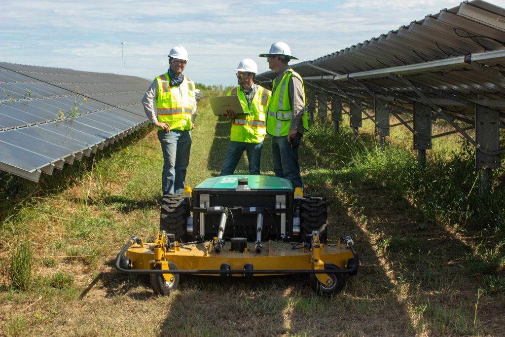 From left: Hatchbed's Kris Kozak and Marc Alban work on the Renubot with Renu Robotics engineer Michael Blanton Jr. at a solar farm in San Antonio, TX. Photo courtesy Renu Robotics.