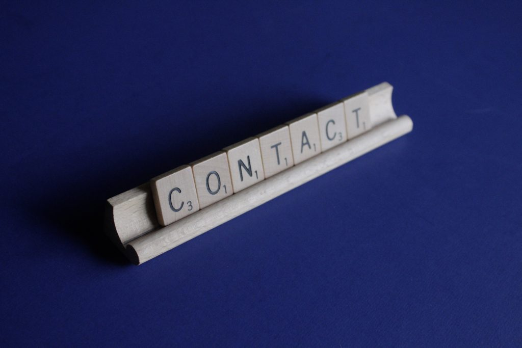 "Scrabble tiles spelling out the word ""contact."" Photo by Melinda Gimpel on Unsplash"