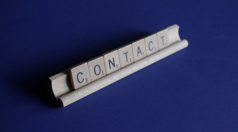 """Scrabble tiles spelling out the word """"contact."""" Photo byMelinda GimpelonUnsplash"""