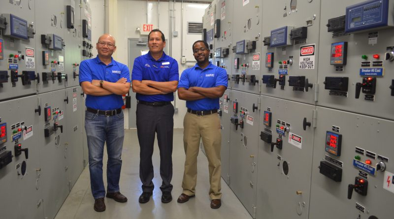 UTSA energy manager Dagoberto Rodrizuez (center) worked with Leaptran's Jeff Xu (left) and Edward Hooks to pilot Leaptran's remote energy monitoring technology. Photo credit: UTSA.