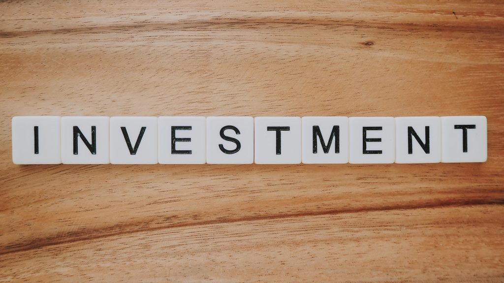 """Tiles spell out """"investment."""" Photo by Precondo CA on Unsplash."""