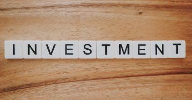 "Tiles spell out ""investment."" Photo by Precondo CA on Unsplash."