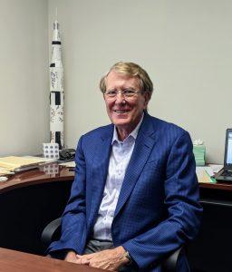 Doug King talks about SAMSAT in his office, photo credit Startups San Antonio