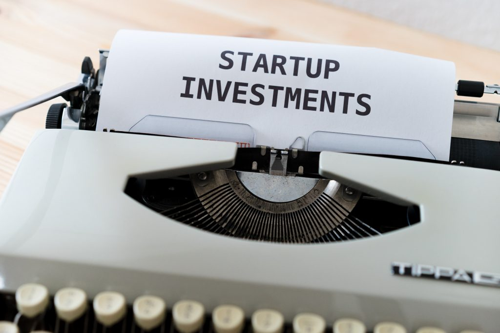 'Startup Investments' typed on a paper in a typewriter. Photo by Markus Winkler on Unsplash.