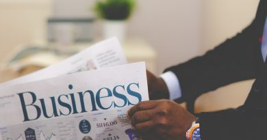 An African American entrepreneur reads a business publication. Photo by Adeolu Eletu on Unsplash.