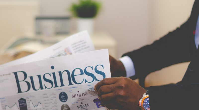 An African American entrepreneur reads a business publication. Photo by Adeolu Eletu on Unsplash.