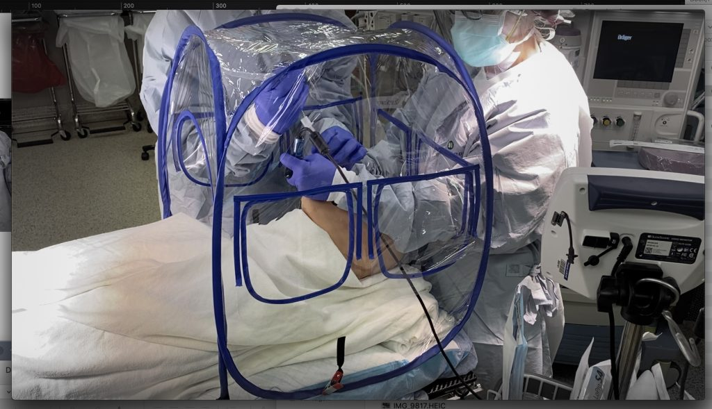 Olifant Medical developed a STAT Enclosure hood to protect healthcare providers while helping a patient, courtesy photo.