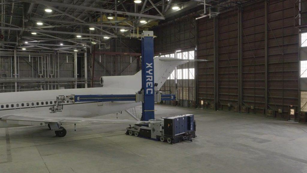 Xyrec robotic arm is removing laser coating on a plane at Port San Antonio, courtesy photo
