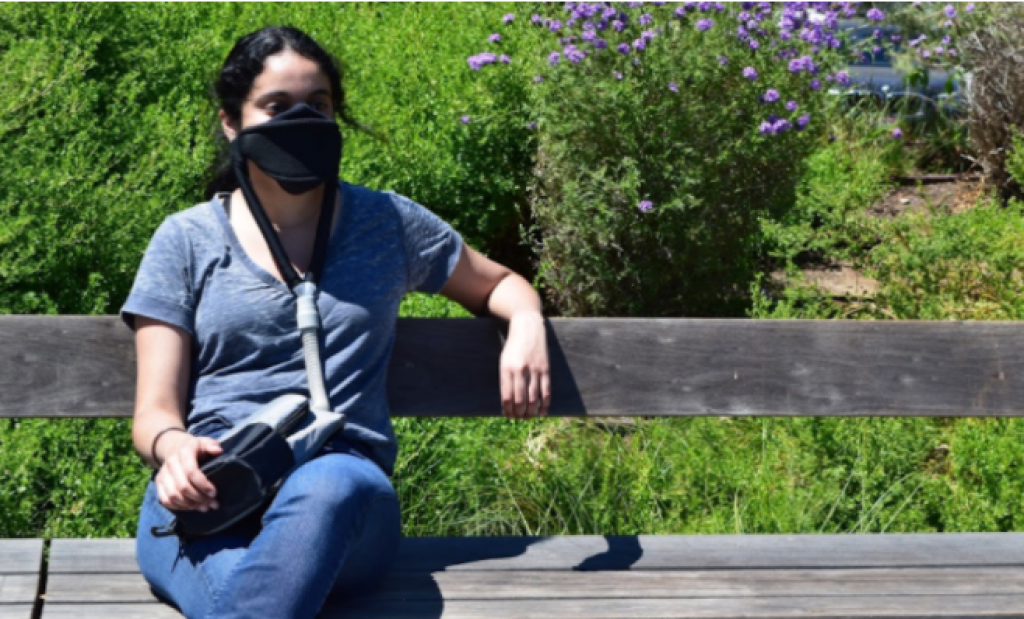 A woman wears the JustAir portable powered face mask system, courtesy photo.
