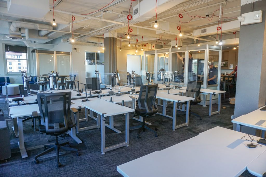 Geekdom dedicated solo desks can be reserved and are surrounded by a plexiglass barrier, courtesy image.