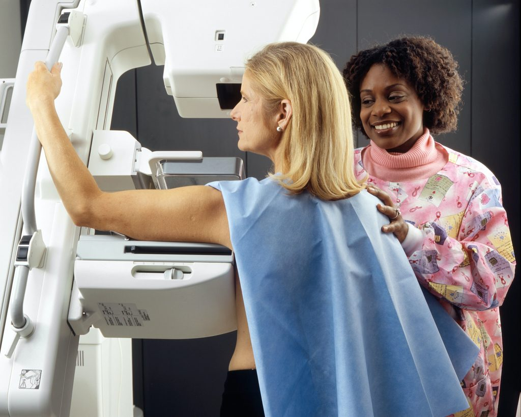 Image of a woman getting a mammogram. Photo credit: National Cancer Institute.