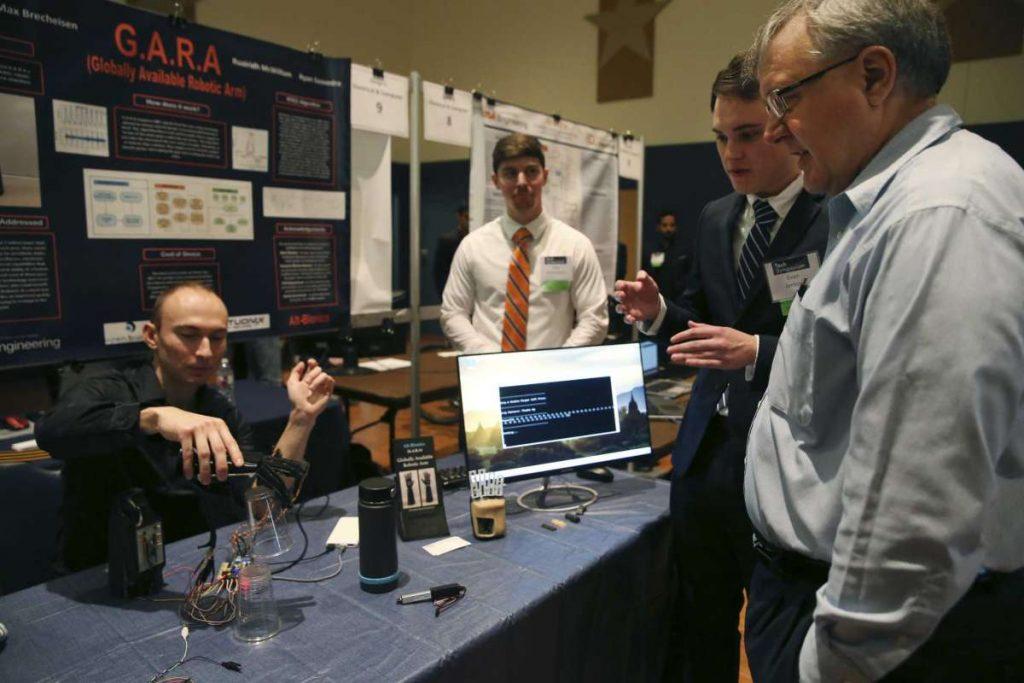 Alt-Bionics founder Ryan Saavedra demonstrates his bionic hand at the UTSA Tech Symposium, courtesy image