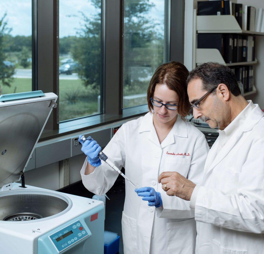 Texas Biomed president and CEO Dr. Larry Schlesinger (right) stands nex to Dr. Eusondia Arnett, courtesy photo