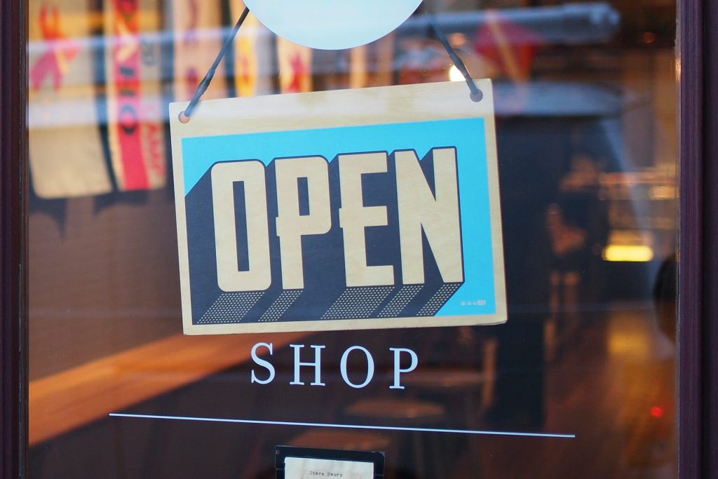 A shop's open for business sign, photo by Mike Petrucci on Unsplash